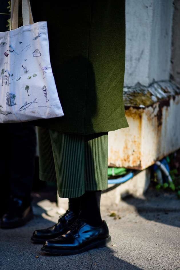 Street style photo of men wearing directional fashion