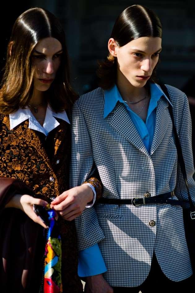 Street style photo of women wearing directional fashion